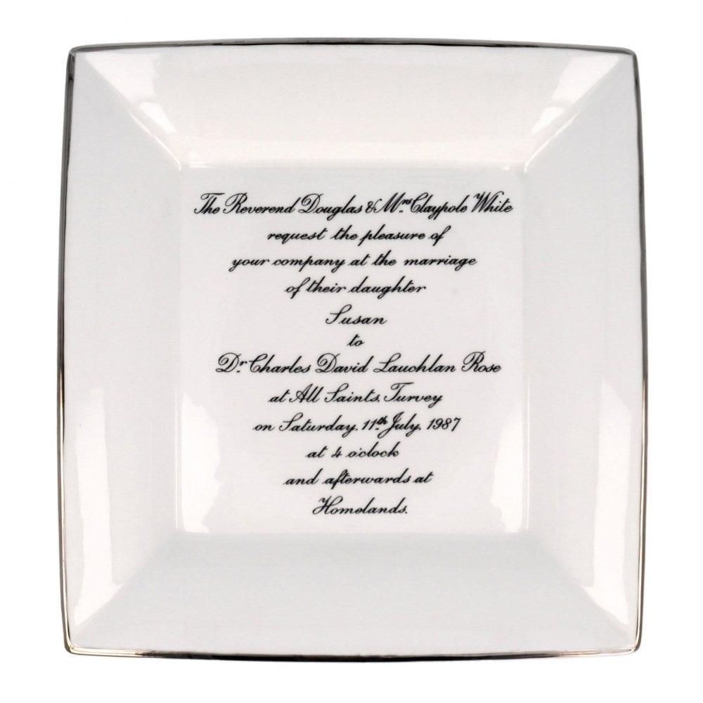 large square dish with wedding invite