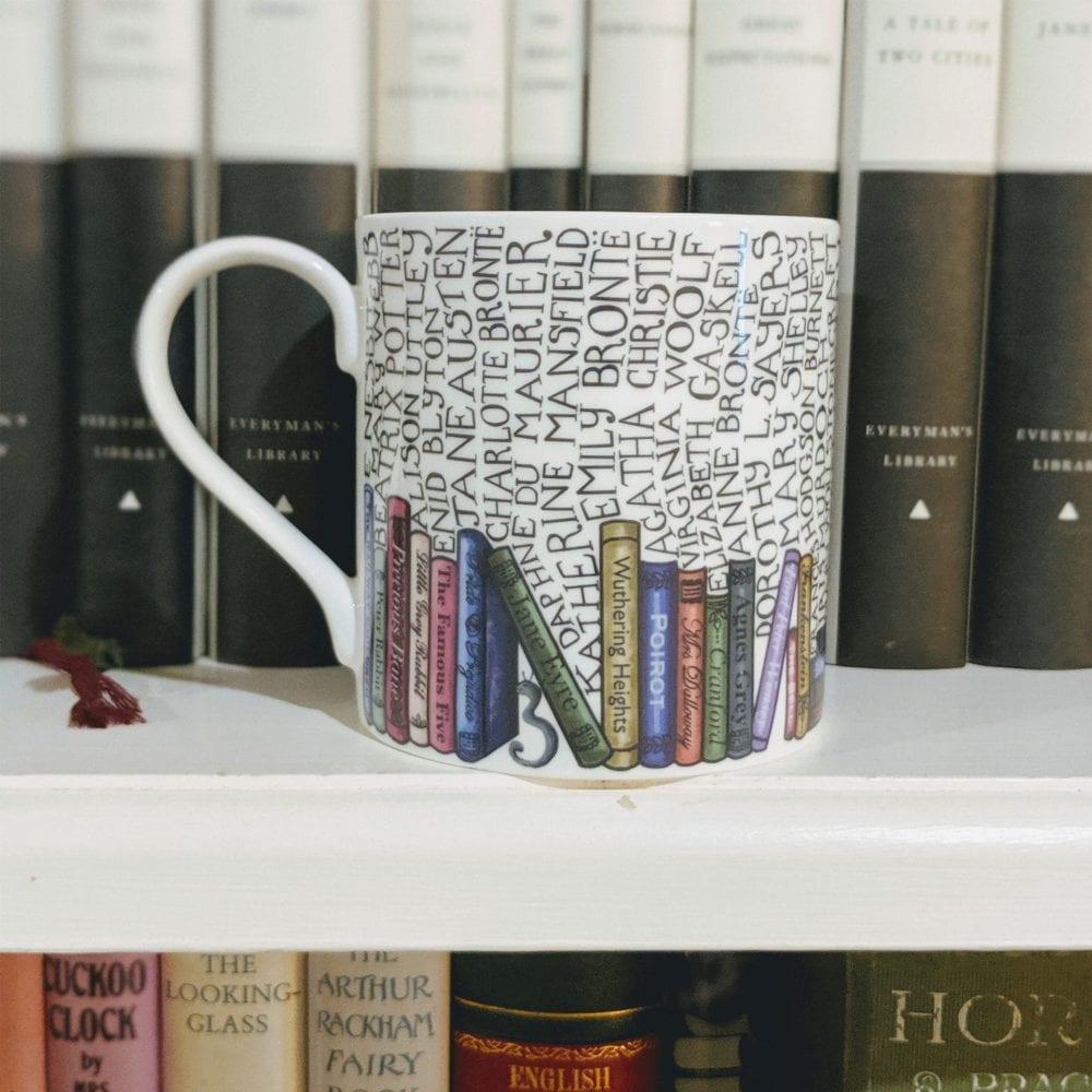 Bookworm mug in front of bookshelf